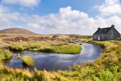A cottage perched on the Isle of North Uist in the Outer Hebrides in Scotland