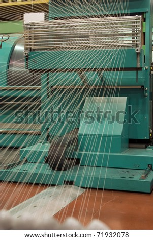 A cotton yarn reel in the factory. - stock photo