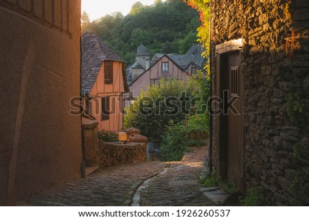 A country lane in the quaint and charming medieval French village of Conques, Aveyron, a popular summer tourist destination in the Occitanie region of France. Photo stock ©