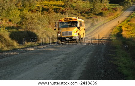 A country school bus makes it's way along its route