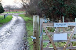 A countryside sign stating that no unauthorized vehicles are allowed beyond that point. Private, keep out, trespassing concept
