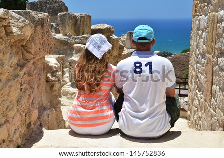 A couple among ancient ruines of Kourion in Cyprus