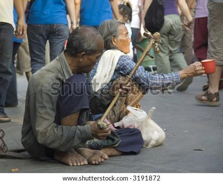 A couple begging in weekend mark Bangkok Thailand