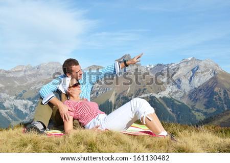 A couple enjoying Alpine panorama. Switzerland