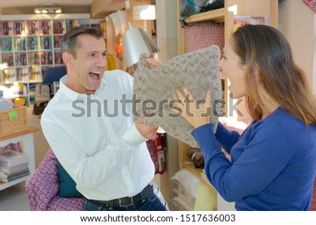 a couple fights over a pillow