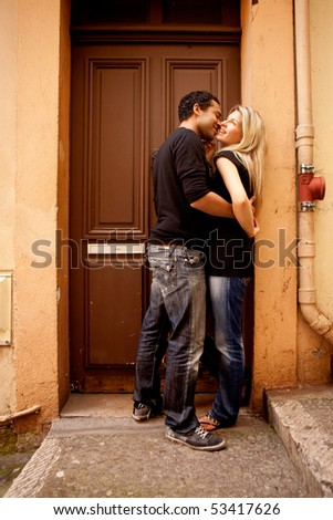A couple having fun and flirting in an European French Street
