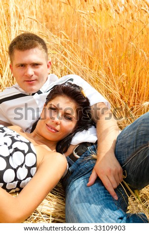 A couple having rest in the wheat field