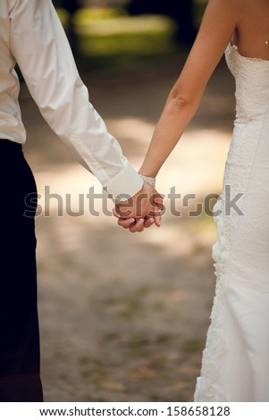 A couple holding hands