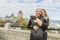 A Couple in front of Chateau Frontenac at Quebec city Canada