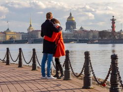 A couple in love on the Neva embankment in St. Petersburg