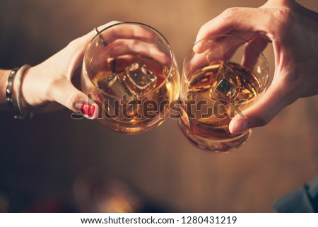 A couple makes a toast with whiskey #1280431219