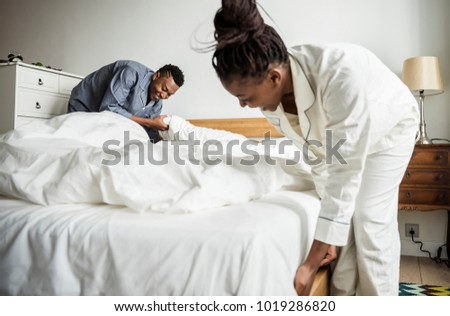 A couple making bed
