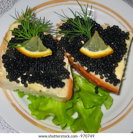 A couple of black osetrova caviar sandwiches which were cooked in an one Russian restaurant.