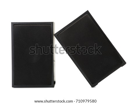 A couple of black simple loudspeakers isolated on a white background. Audio equipment for sound quality, close-up. #710979580