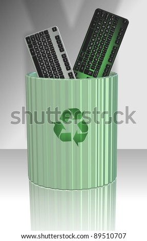 A couple of computer keyboards disposed in a recycling bin / Recycled keyboard