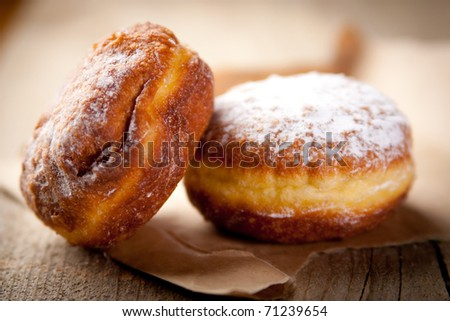 A couple of donuts on wrapping paper - stock photo