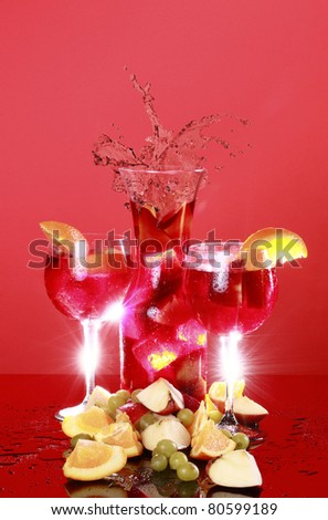 A couple of glasses of cold red Sangria and splashing carafe