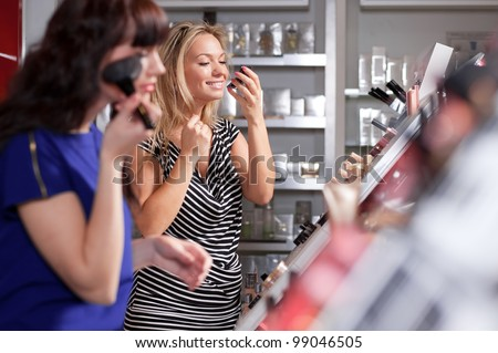 A couple of women enjoy themselves in a beauty store