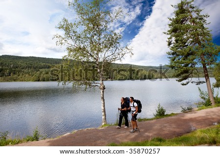 A couple on a camping trip by a lake