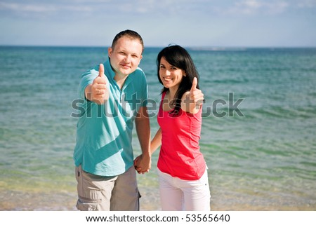 A couple on beach have fun