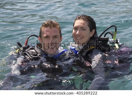 A couple scuba diving #405289222