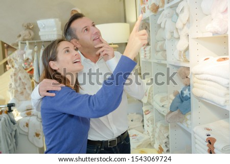 a couple selecting the first toys #1543069724
