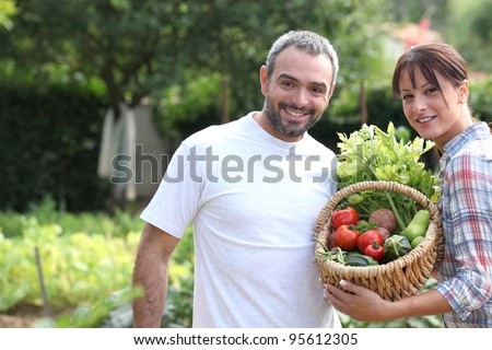 A couple taking care of their vegetable garden.