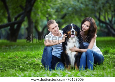 A couple with a dog in the park