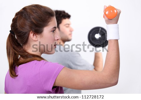 A couple working out.