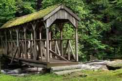 a covered bridge  spanning willard brook in willard brook state forest in townsend.