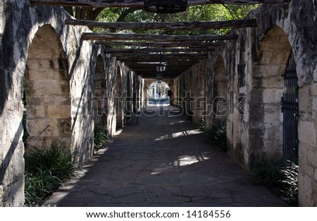 A covered walkway on the Alamo that leads to the street.