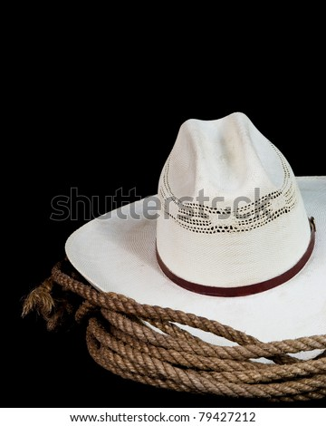 a cowboy hat and lasso on a black background