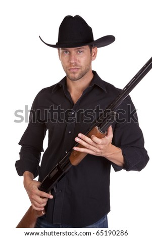 a cowboy holding his rifle in his hands with a serious expression on his face.