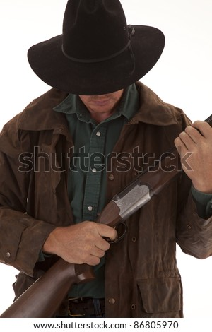A cowboy on a white background holding on to his rifle.