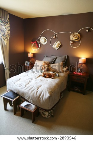 A cowboy rodeo themed bedroom inside an upscale home