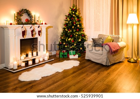 A cozy living room full of warm light from decorations for a coming Christmas, nice fireplace, soft sofa and a great tree. Room Christmas Tree Fireplace Light, Xmas Home Interior Decoration.