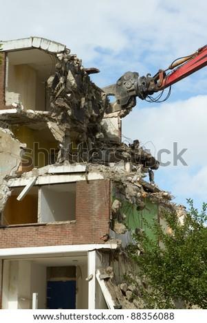 A crane is demolishing a block of flats