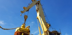 a crane lifts a pile during offshore construction operation