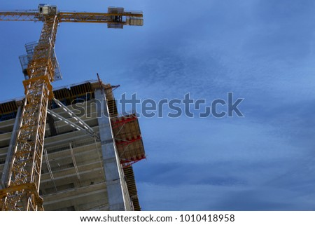A crane near building. The building is in the process of building. #1010418958