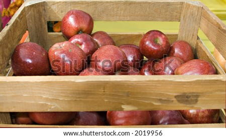 A crate full of apples at the market.