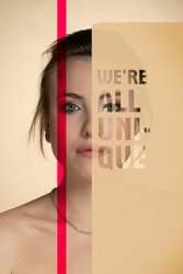 a creative image telling that each person is unique: a portrait of a beautiful girl covered with two inserts, one red transparent and one beige with a transparent inscription we are all unique