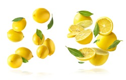 A creative set with Fresh raw whole and cut lemons with green leaves falling in the air isolated on white background. Food levitation or zero gravity conception. High resolution image