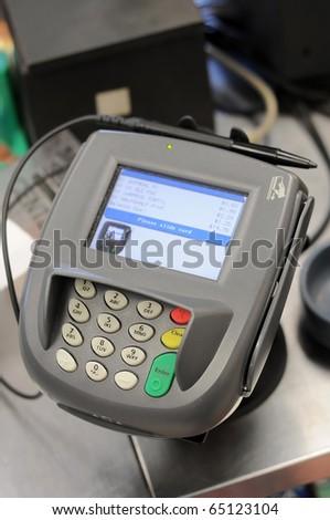 A credit card machine in a store.
