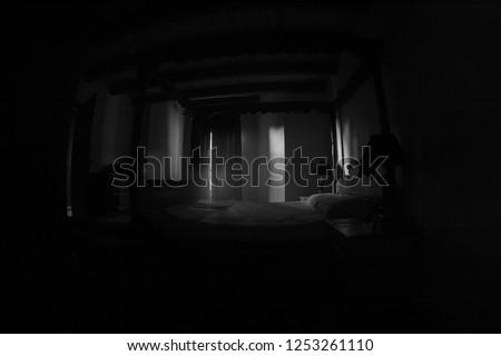 A creepy bedroom scenery, Antique scary bedroom with window . Dark room. Horror concept