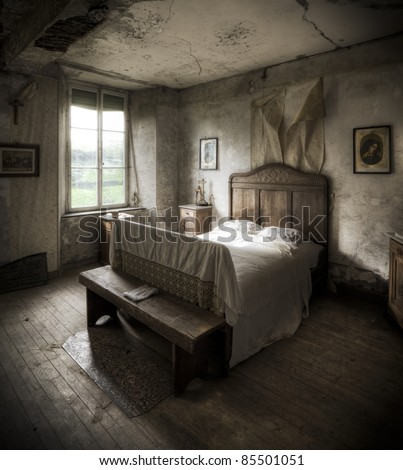 A creepy bedroom scenery, cracked walls and wooden floors along with a religious atmosphere.