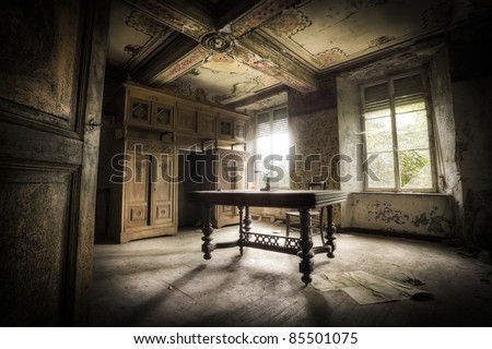 A creepy scenery, this old table creating a moody atmosphere along with the magnificent light.