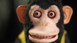 A  creepy vintage cymbal monkey toy