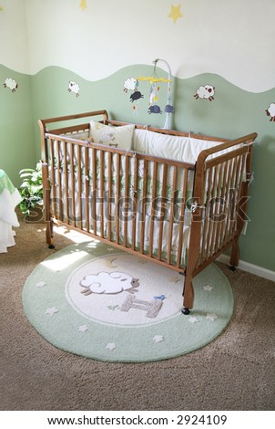 A crib in a baby room interior inside an upscale home