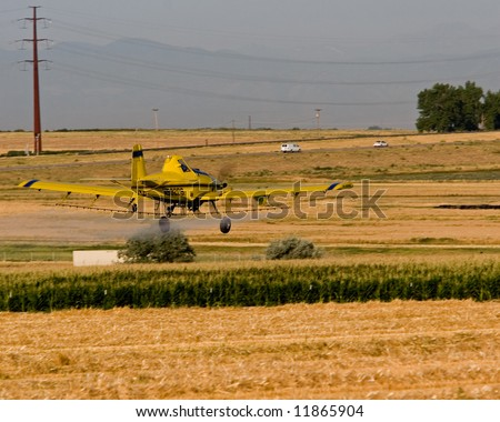 A crop duster working a corn field in Eastern Colorado