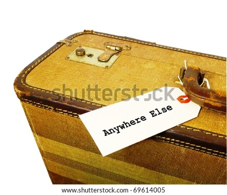 "a crop of a worn vintage suitcase with a white tag that says ""Anywhere else"" attached to the handle isolated on a pure white background"